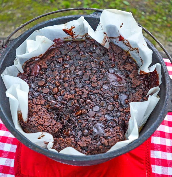 a dutch oven with a chocolate dump cake in it