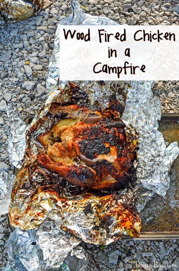 Wood Fired Chicken in a Campfire Recipe - Love the taste of a roasted chicken? Get that amazing wood fired taste while camping by roasting a whole chicken in a campfire. This recipe is easy to make.