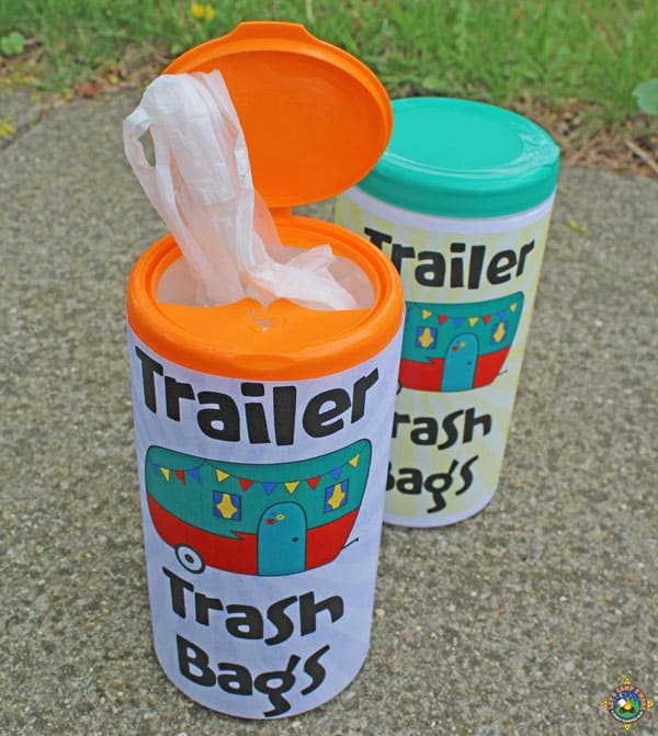 containers filled with trash bags for camping