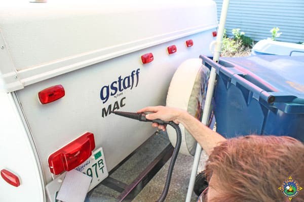 decal being removed from the back of an RV