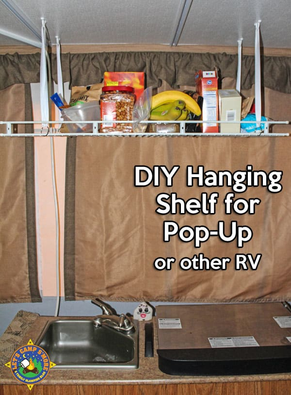 Simple DIY Hanging Shelf Hack for a Pop-Up Camper - Make this simple hanging shelf with an old wire shelf and a few other inexpensive items. It helps you keep the trailer organized. #PopUpCamper #trailer #mod #DIY