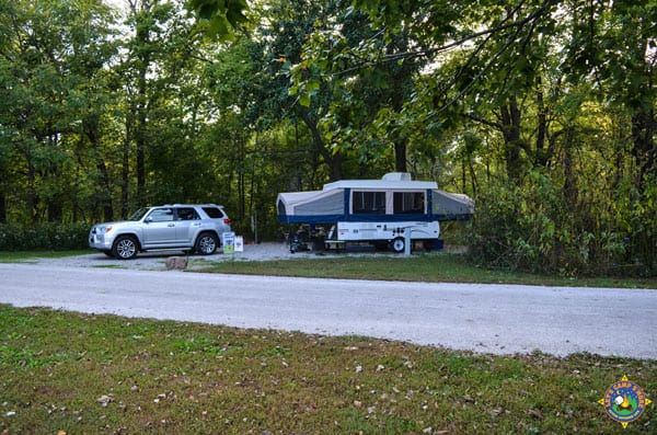 campsite with a pop-up camper trailer