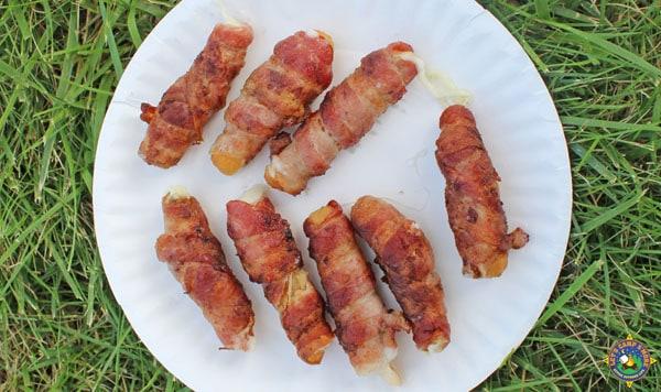 bacon mozzarella sticks on a plate