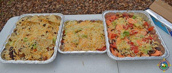 3 pans of prepared nachos