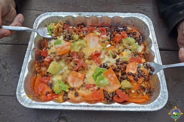 sweet potato nachos being eaten with forks