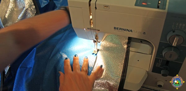 solar blanket pieces being stitched together with a sewing machine