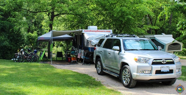 campsite with a popup trailer and a Toyota 4Runner
