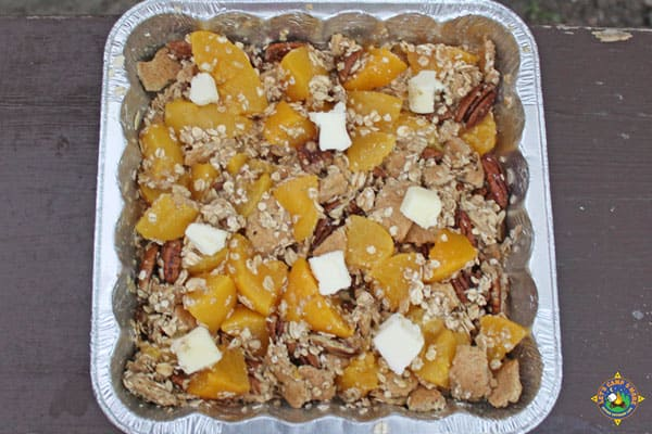ingredients for campfire peach crisp in a foil pan