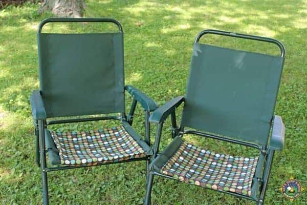 two camping chairs with covers