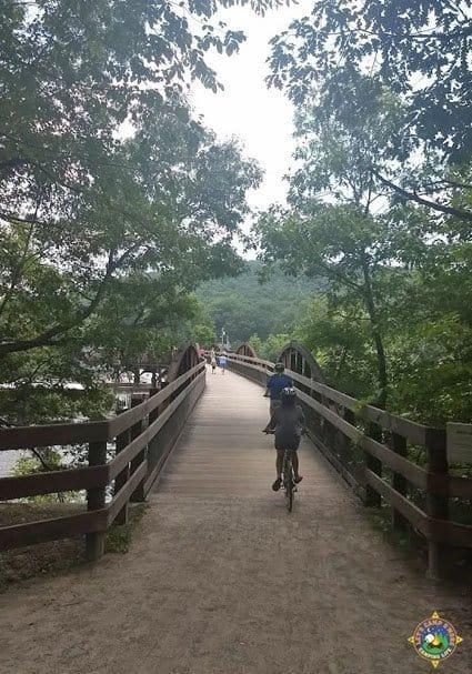 Bikers on a GAP Trail bridge