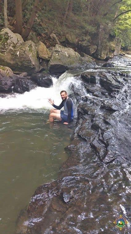 Man on rocks in river