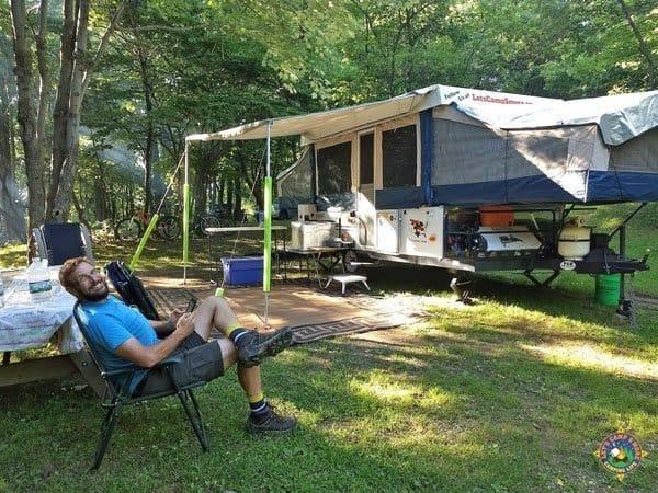 Man camping at Tomlinson Run