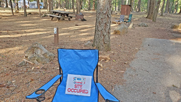 Site Occupied Free Camping Printable on a Camping Chair
