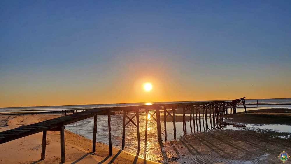 sunrise over a pier in the Gulf of Mexico in Mississippi