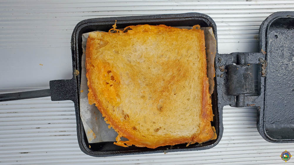 close up of a pie iron grilled cheese sandwich