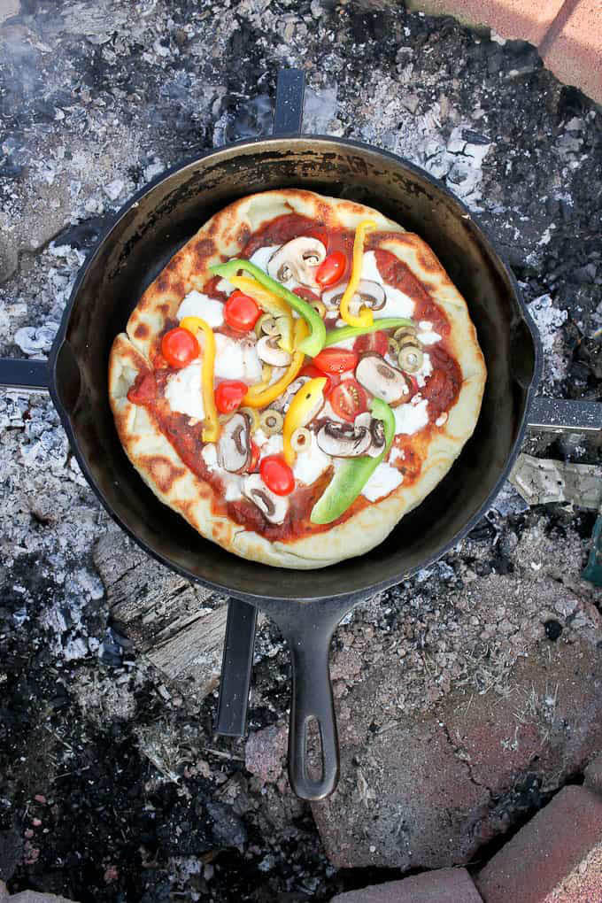 vegetarian pizza made over the campfire