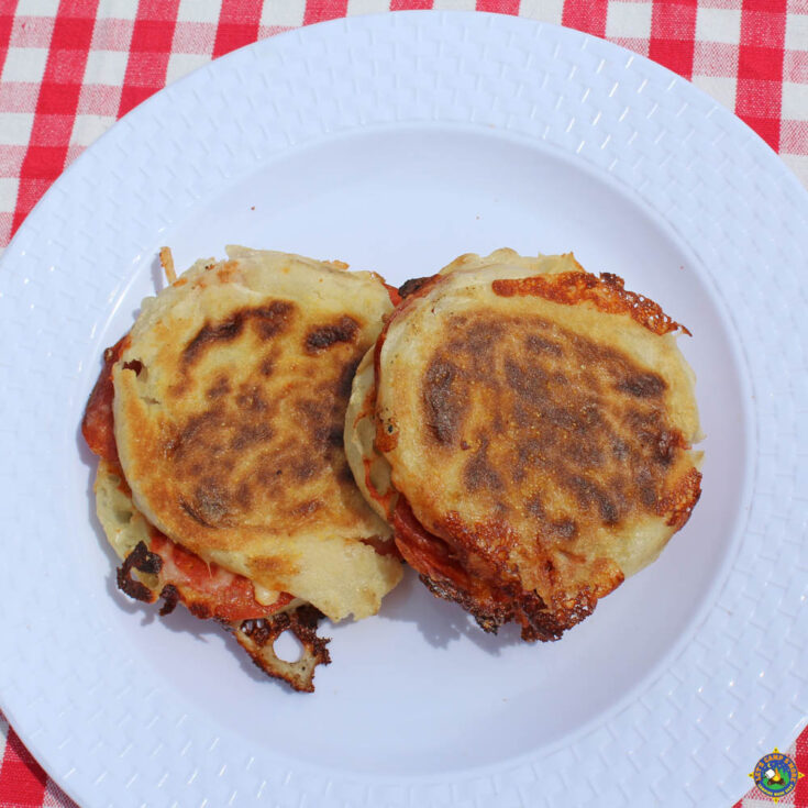 two perfectly grilled pizza sandwiches