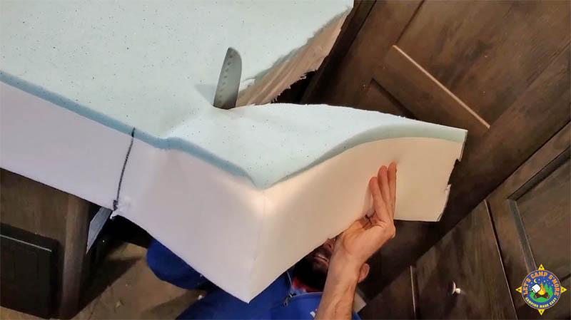 cutting a memory foam to create a custom RV mattress