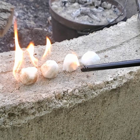 cotton balls being lit on fire