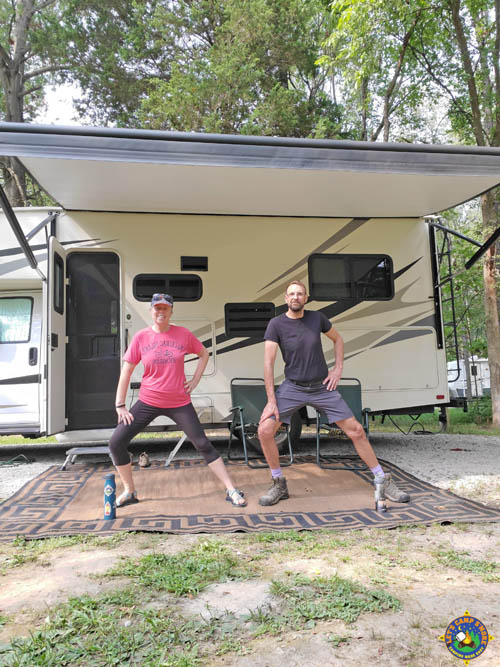 couple stretching outside of a motorhome