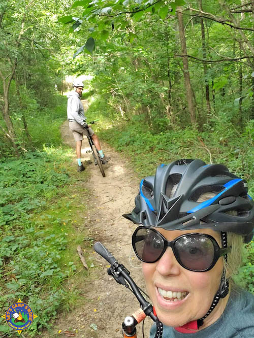 selfie of a couple mountain biking