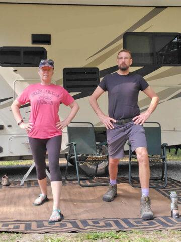 couple exercising outside of a motorhome