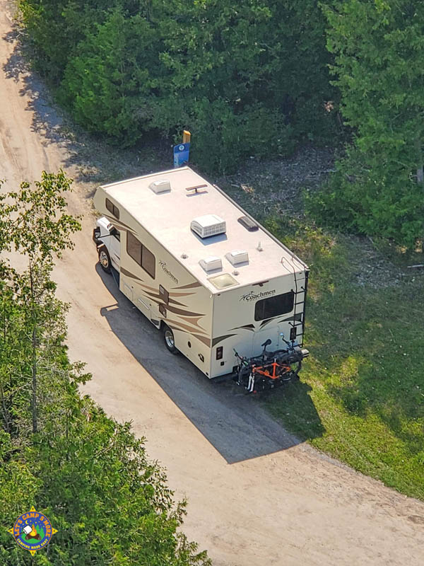aerial photo of a motorhome taken from the top of a lighthouse in Michigan