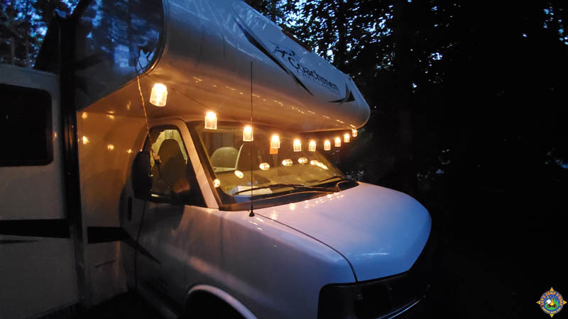 decorative lights hanging across the front of a motorhome and reflecting in the windshield