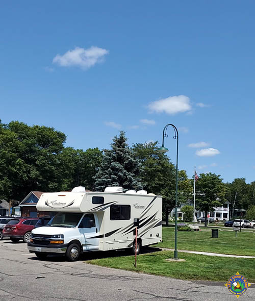small motorhome parked in a regular parking space